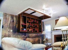 Hidden drop ceiling weapons storage.  I think my living room needs a little remodeling!