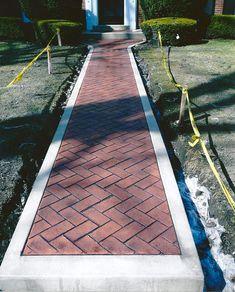 Herringbone Stamped Concrete With Concrete Border.