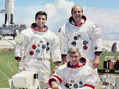30 Sep 1971 | Prime crew for Apollo 17 lunar landing mission are: Commander, Eugene A. Cernan (seated), Command Module pilot Ronald E. Evans (right), and Lunar Module pilot, Harrison H. Schmitt. They are photographed with a Lunar Roving Vehicle (LRV) trainer. Cernan and Schmitt used an LRV during their exploration of the Taurus-Littrow landing site. The Apollo 17 Saturn V Moon rocket is in the background. This picture was taken at Pad A, Launch Complex 39, Kennedy Space Center (KSC)…
