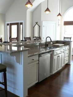 Raised bar kitchen island. Would be great with cabinets on barstool side as well for extra storage.