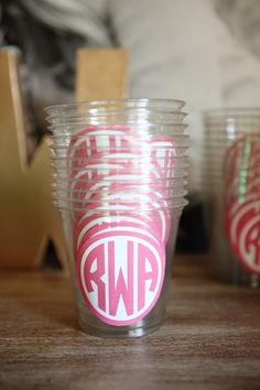Monogram cups. Pretty sure I can DIY these for the wedding in a different color