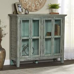 Lark Manor Eau Claire 4 Door Accent Cabinet..a gorgeous cabinet, love the distressed look and vintage charm..beautiful for any farmhouse|rustic|country|vintage home..#ad #homedecor #cabinet