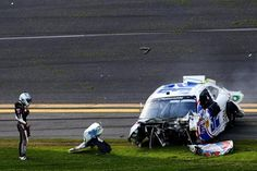 A crash injured at least a dozen fans Saturday at Daytona. Driver Kyle Larson after exiting his destroyed nationwide # 32