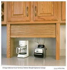 This one is kind of ugly but the concept is pretty good.  Like a break box with the roll up door.  Would a toaster oven and coffee pot all fit?  I don't know if my space from counter to cabinet is enough for a coffee maker to lift the lid for refilling the water.