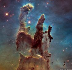 "The Hubble Space Telescope, which in 2015 completes 25 years in orbit, has gathered dramatic new views of two well-known celestial objects.  Revisiting one of its earliest and most famous photos, a new view of the Eagle Nebula shows its ""Pillars of Creation"" in more detail than ever before; the Eagle Nebula and the Andromeda Galaxy."