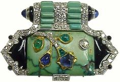 Diamond, Turquoise, Emerald, and Sapphire Brooch by Cartier.