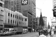 Downtown Rochester NY | From left: Three Sisters clothing store at Main and Clinton, F. W. Woolworth Co. and McFarlin's and Lincoln Rochester's present building. TU 12/19/1967