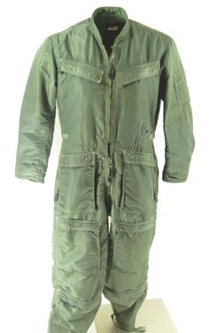 <p>The CWU-1/P flight suit was designed in the late 1950s, put into service in the sage green color used Vietnam war in the early 60s. It was designed using heavy duty rayon to work along side of the new equipment needed in fighter jets. This is a great example of military hardware history and has a QM (quarter master) number dating it to 1961.</p>
