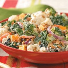 Festive Broccoli-Cauliflower Salad Recipe Salads with broccoli, cauliflowerets, green pepper, carrots, purple onion, pitted olives, sharp cheddar cheese, dressing, mayonnaise, ranch dressing, italian seasoning, garlic powder, dill weed, sunflower kernels