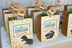 DIY Dinosaur Party Theme Favor Bags.  These personalized goodie/loot bags are very simple to make and include the tags.  Simply download, print cut and paste. #dinosaur #party