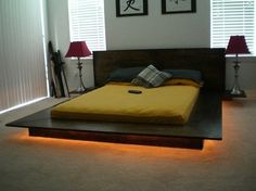 Japanese influenced platform bed. Low Profile and modern styled with integrated side tables. Integrated lighting makes this platform bed appear to be floating. Made of durable Red Oak, this bed will take a lot of abuse.