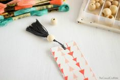 Image from http://www.thecasualcraftlete.com/wp-content/uploads/2015/04/DIY-Fabric-Bookmarks-with-Embroidery-Floss-Tassels-.jpg.