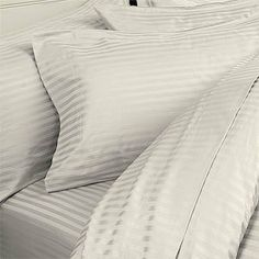 """8PC Full 1500 Thread Count Bed In a Bag - Ivory Stripes Sheet Set, Duvet Set & Down Alternative by Egyptian Bedding. $399.99. 1 Flat Sheet (86"""" x 96""""), 1 Fitted Sheet (54"""" x 75"""") and 2 Standard Pillow Cases (20"""" x 30""""). Luxury White Siberian Down Alternative Comforter - 86 x 86 Inches. True baffle box design to keep the down in place. Beautiful Duvet Set (1 Duvet Cover, 2 Shams). Brand New and Factory Sealed.. This Luxury 8-Piece Bed in a Bag Down Alternative Comforter Set con..."""