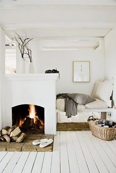 Cozy white.  My dream is of a fireplace in the master BR and this one is so light & airy but also cozy. Yes please!