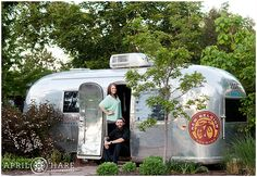 Engagement photos at the Fat Tire New Belgium Brewery Airstream in Fort Collins Colorado. - April O'Hare Photography http://www.apriloharephotography.com #FortCollins #NewBelgium #FatTire #CraftBeer #CraftBeerEngagementPhotos #Colorado #ColoradoPhotographer #EngagementPhoto #RangerIPA #UniqueEngagementPhoto #FortCollinsPhotographer #gardenengagement #VintageAirstream #VintageTrailer