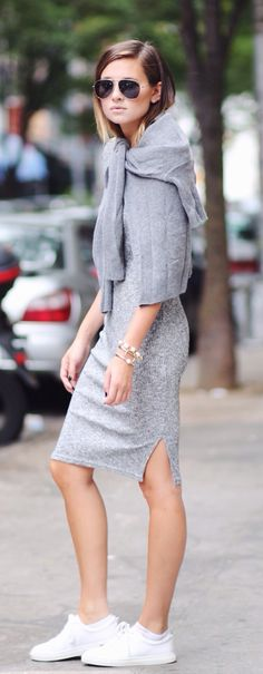 Danielle Bernstein is wearing a grey dress from Asos, matching jumper from Zara and the white sneakers from Sandro