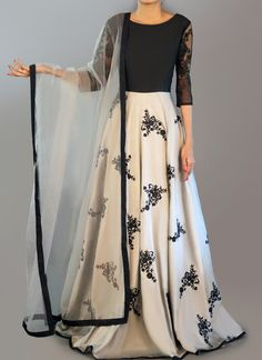Light Grey and Black Embroidered Anarkali is on taffeta silk fabric and features a santoon inner and bottom alongside a net dupatta and lace arms. Embroidery work is completed with thread and lace embellishments. Lehenga Designs, Indian Attire, Indian Wear, Pakistani Outfits, Indian Outfits, Look Fashion, Indian Fashion, Dress Outfits, Fashion Dresses