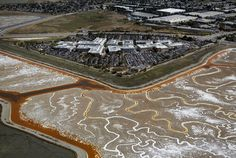 The Facebook campus sits next to the Menlo Park Baylands amid the rich colors of the drying mud flats in Ravenswood Slough in this aerial view taken