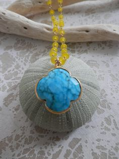 Turquoise Quatrefoil Clover on a Yellow by ransomjewelry on Etsy, $44.00