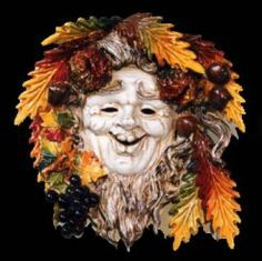 """4-SEASON - AUTUMN CERAMIC MASK (WALL DECOR): 14"""" (35cm) in Diameter.    The ceramic masks made for SABBIA TALENTI are completely hand-made in Florence Italy and the gorgeous fruit surrounding each mask is painstakingly hand-applied."""