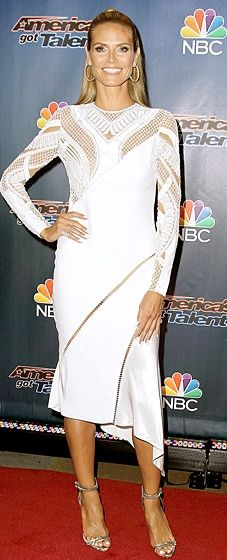 """Heidi Klum wore a long-sleeved Versace dress with lattice detailing along the neck and sleeves to the """"America's Got Talent"""" Season 9 Pre-Show."""