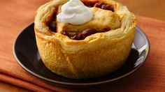 INGREDIENTS  1can (16.3 oz) Pillsbury® Grands!® Flaky Layers refrigerated original biscuits (8 biscuits)  1/2cup shredded Cheddar cheese (2 oz)  1can (15 to 16 oz) chili  Sour cream, if desired