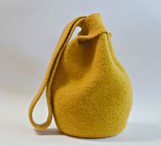 This variation on the Japanese knot bag is larger with a shoulder length strap for everyday use. The soft shape gives the bag an easy boho feel. It is knit in the round in one piece- the only seaming is grafting at the midpoint of each strap (complete instructions are provided if you haven't grafted before). Complete instructions are also provided for how to felt the piece in a washing machine.