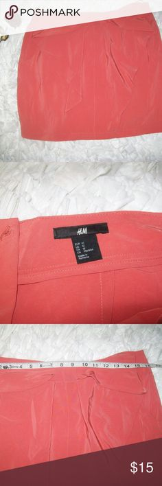 H&M Orange Mini Pencil Bow Tie Front Skirt H&M Orange Mini Pencil Bow Tie Front Skirt Size 12. Item is in good shape with no stains. Small hole on the bow where the store put a tag. Zips up the back. See pictures for measurements. Check out my store for more items. Will consider all offers. H&M Skirts Mini