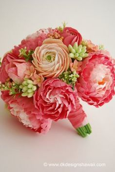 coral bouquet - coral pink peonies in varying shades, ranunculus in coral pink and peach tones, hyacinth in peach with pink edged petals, tuberose buds with a peach hue, and tulips