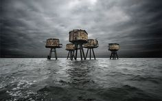 MAUNSELL FORTS, THAMES ESTUARYJUTTING OUT OF THE WATERS OF THE THAMES ESTUARY, THE MAUNSELL FORTS SLOWLY RUST. BUILT IN 1942, THESE OFFSHORE FORTIFIED TOWERS WERE DESIGNED TO PROVIDE ANTI-AIRCRAFT FIRE DURING THE SECOND WORLD WAR. AFTER THEY WERE DECOMMISSIONED IN THE LATE 1950S, A NUMBER OF THE STRUCTURES WERE RE-OCCUPIED BY PIRATE RADIO STATIONS. HOWEVER, FOR THE PAST THREE DECADES THE FORTS HAVE STOOD ABANDONED AND LARGELY UNKNOWN.