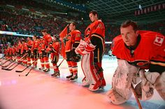Miikka Kiprusoff and teammates of the Calgary Flames stand for pre-game ceremonies against the San Jose Sharks on January 2013 at the Scotiabank Saddledome in Calgary, Alberta, Canada. Nhl Games, San Jose Sharks, Fire And Ice, Calgary, Hockey, January 20, Sports, Alberta Canada, Image