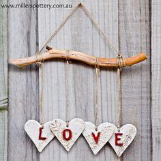 Australian handmade ceramic LOVE mobile by www.millerspottery.com