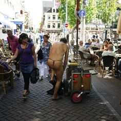 This dude was in Leidseplein pushing around a little cart. He undressed down to his thong and rested his clothing on said little cart. Armed with only a thong and a tray to collect tips, he walks through the densely packed area where everybody is eating at, collecting said tips. About €40 later, he goes back to his cart and puts his clothes back on…