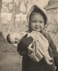 Little girl with her doll looks like the 1940's