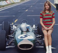 Francoise Hardy sitting on a Formula One race car during the filming of Grand Prix, 1966. –Photo by Francois Gragnon
