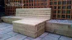 Bespoke Wooden Seat with Sleeper Retaining Wall