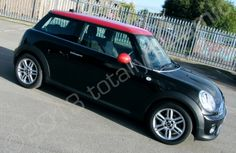 MINI wrapped in a gloss metallic black vinyl car wrap with a gloss red vinyl roof by Totally Dynamic Leeds
