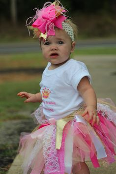 Baby Girl's 1st Birthday Photo By Gwendolyn Willis.  Custom tutu, shirt and bow by Pam Moon at Moonstruck Boutique in Coalgate, OK
