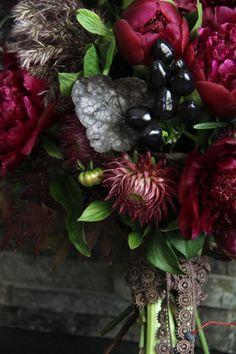 Red charm peonies, dahlia, ornamental peppers, smoke bush, rosemary, and fall leaves berries.