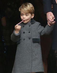 BUCKLEBURY, BERKSHIRE - DECEMBER 25:  Prince George of Cambridge licks a candy cane at Church on Christmas Day on December 25, 2016 in Bucklebury, Berkshire.  (Photo by Danny Martindale/WireImage) via @AOL_Lifestyle Read more: http://www.aol.com/article/lifestyle/2016/12/25/kate-middleton-prince-william-and-family-attend-christmas-servi/21641812/?a_dgi=aolshare_pinterest#fullscreen