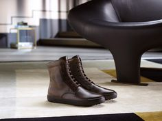 A casual chic staple: leather ankle boots with intense shading and signature gommini detailing on the box rubber sole. #tods #menswear #fw15