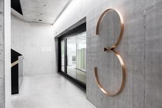 giant cupper-like number for floor signage in business or residential building Floor Signage, Hotel Signage, Directional Signage, Wayfinding Signs, Environmental Graphic Design, Environmental Graphics, Commercial Design, Commercial Interiors, Architectural Signage