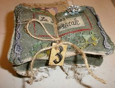 Three sachets, images and lace.  Tied with a tag