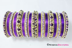 Stunning Purple Bangle Set.   This is a must have for any bangle collection. Wear alone or with a mix of coloured bangles to match an outfit.  The purple is a gorgeous rich purple on the cool tone side.  More representative of the usual Cadbury Purple. The gold accent bangles are a rich bright yellow gold.   This is a set of bangles which are suitable for both hands, however, I recommend two sets for a full bridal look.  This set features two wide bangles in the middle and four matching…