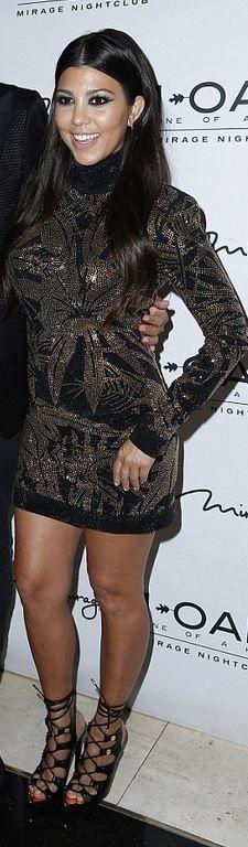 Who made  Kourtney Kardashian's black lace up shoes and studded gold dress?