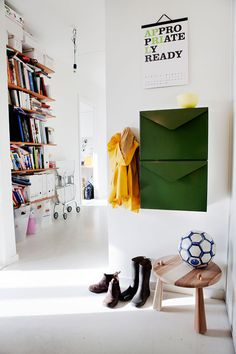 photo by  Nicklas Thegerström   great color palette.  I really want to straighten up the bookshelf