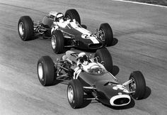 Jackie Stewart (BRM P261) holding off Jim Clark in the Lotus-Climax 33 during the 1965 Italian Grand Prix at Monza this Grand Prix would see Stewart taking his first F1 victory