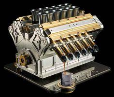 Máquina de café expresso em forma de motor V12 e ouro 18k