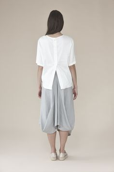 Solid blouse woven with front node 145.00$