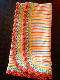 Crotched edged baby receiving blanket